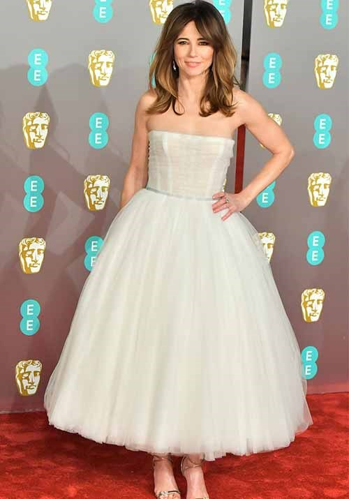 American actress and mum-of-one Linda Cardellini opted for a feminine tulle gown. *(Image: Getty)*