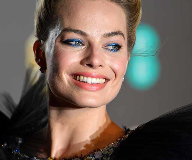 Margot's electric blue eye makeup added an edgy touch to her look. *(Image: Getty)*