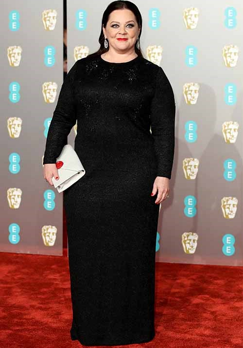Best actress nominee Melissa McCarthy looked chic and classy in a black long-sleeved dress. *(Image: Getty)*