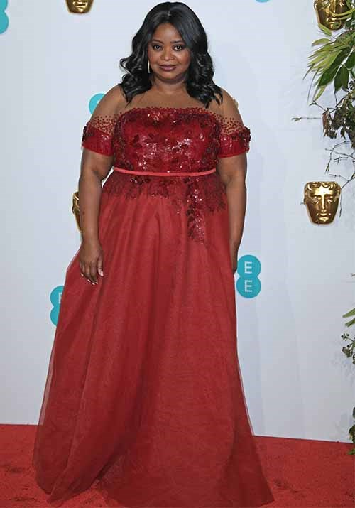 *The Help* actress Octavia Spencer looked gorgeous in a flowing red frock. *(Image: Getty)*