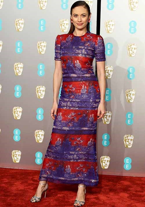 French actress Olga Kurylenko also opted for a bright and bold look - and she pulled it off seamlessly. *(Image: Getty)*
