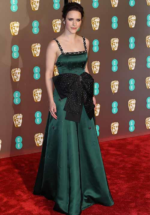 *The Marvelous Mrs. Maisel* actress Rachel Brosnahan's emerald green dress made a big impression with its bold black bow. *(Image: Getty)*