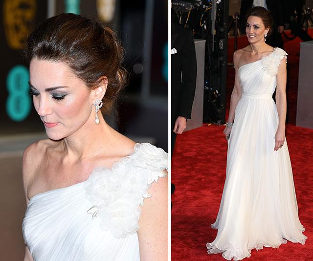 Red carpet Queen: Catherine looked like a total vision in this white asymmetrical gown with floral detailing. *(Images: Getty)*