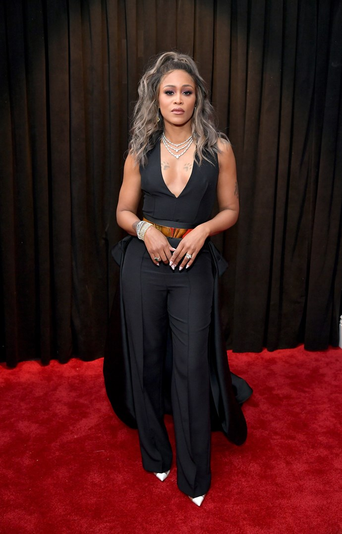 Singer Eve's pant suit is edgy and chic. *(Image: Getty)*