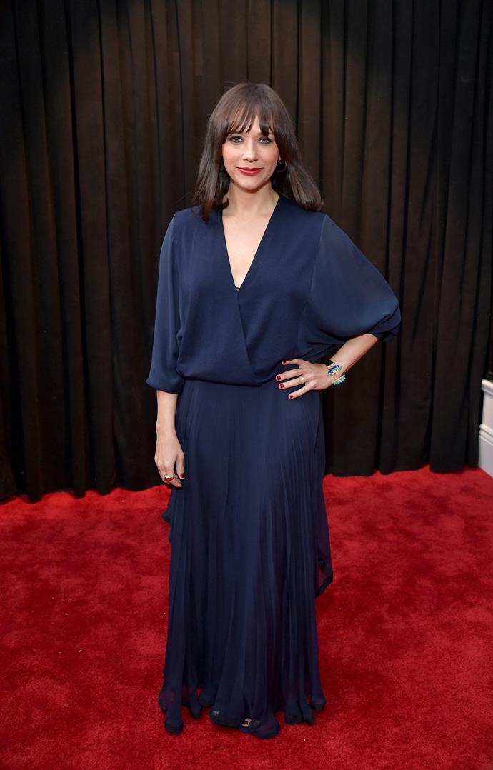 Comedic actress Rashida Jones looks chic in a navy blue frock with a plunging V-neck. *(Image: Getty)*