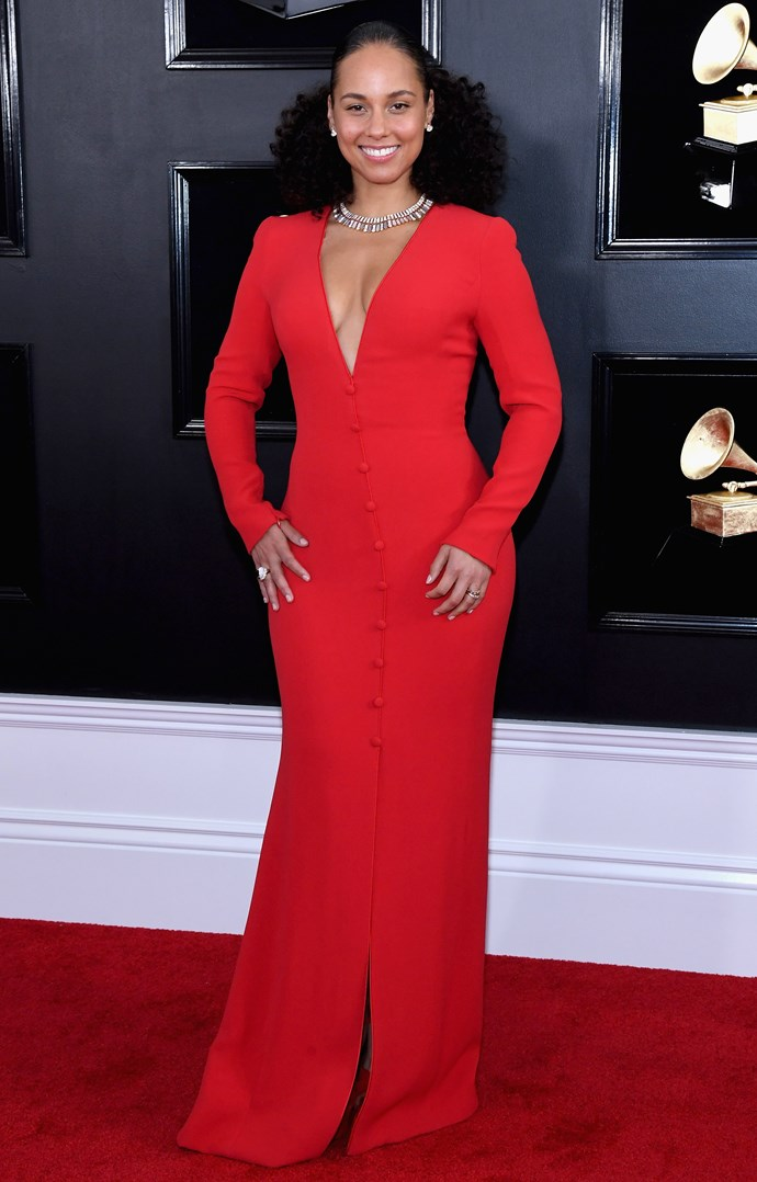 Outfit change! Keys upped the glam in this chic red buttoned gown. *(Image: Getty)*