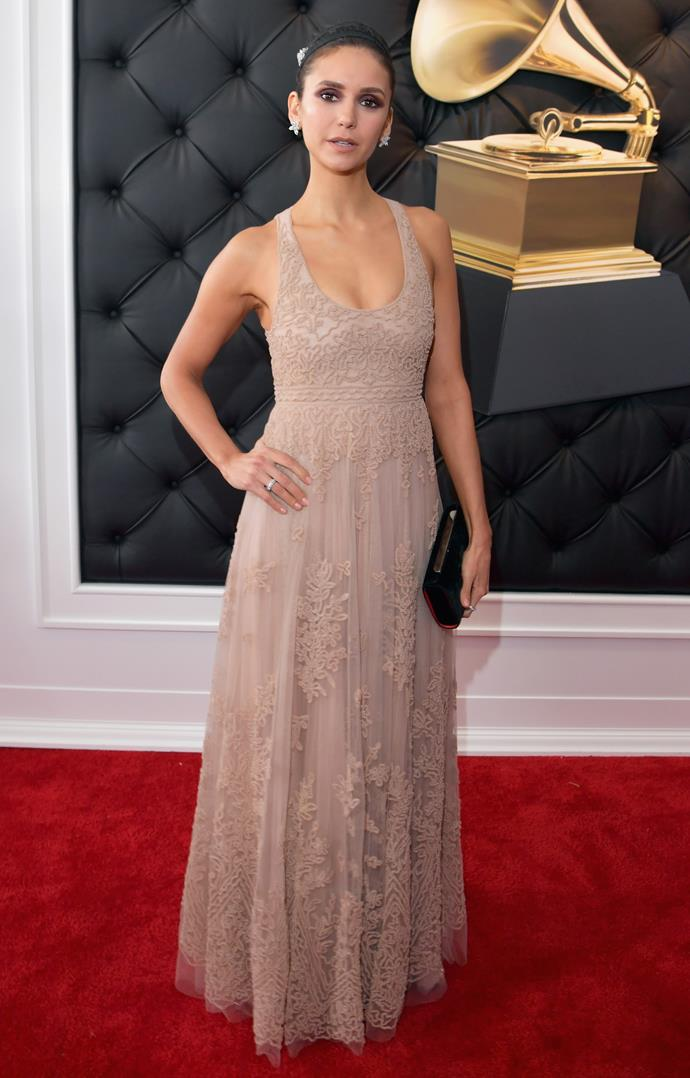 Nina Dobrev providing some tranquillity to the extravagant red carpet in this simple neutral-toned look. *(Image: Getty)*
