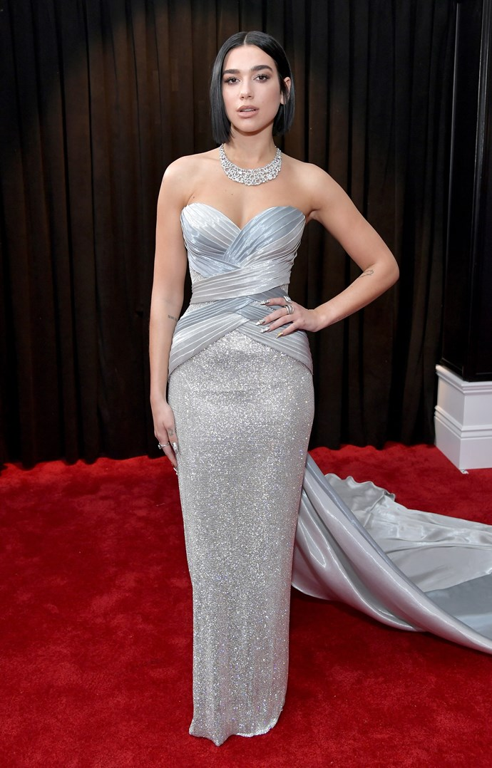 English singer Dua Lipa oozes class on the red carpet in this sparkly silver gown. *(Image: Getty)*