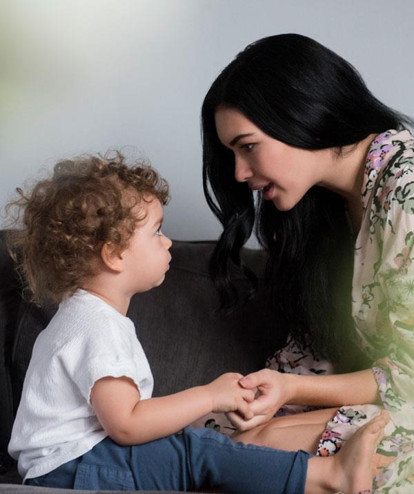Help teach your tot new words by making eye contact when you are talking. *(Image: Getty Images)*