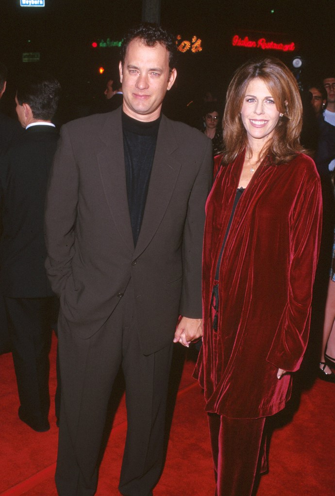 The couple at a film premiere in the 90s. *(Image: Getty)*