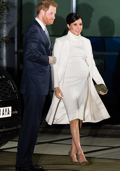 Duchess Meghan and Prince Harry stunned as they stepped out together in London. *(Image: Getty)*