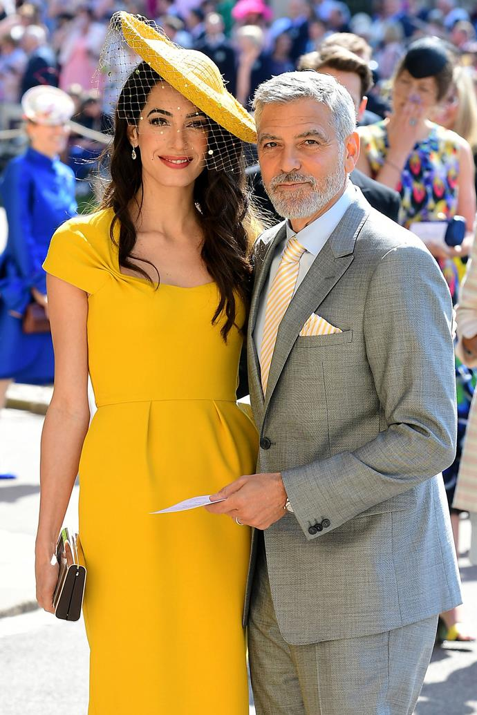 Amal and George Clooney arriving at the royal wedding in 2018. *(Image: Getty)*