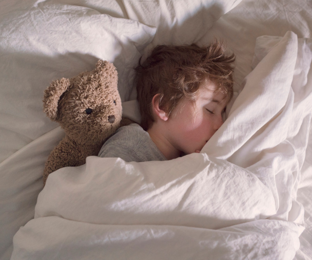 Commitment to a bedtime routine reaps great benefits for the school term. *Image: Getty.*