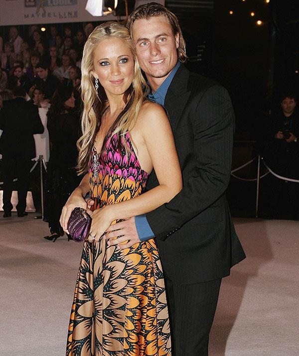 Bec Cartwright and her then fiance Lleyton cuddle up at the 2005 TV WEEK Logie Awards. *(Image: Getty)*