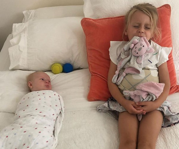 """""""Don't think they'll be fooled by your fake-napping big sis, our parents are waaaay too cluey for that nonsense."""" Chris shared a cute pic of his girls """"napping."""" *(Image: Instagram @walkschris21)*"""