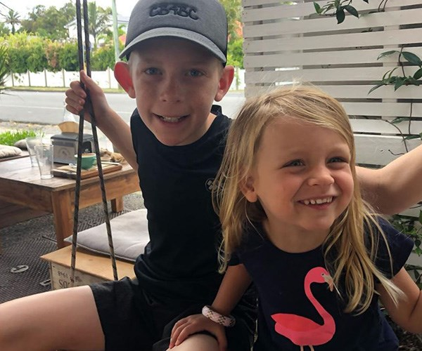 Ollie and Evie look adorable in their matching black outfits. *(Image: Instagram @walkschris21)*