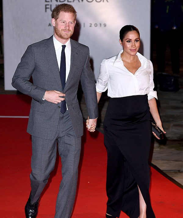 Prince Harry found the shrine to wife rather amusing. *(Image: Getty)*