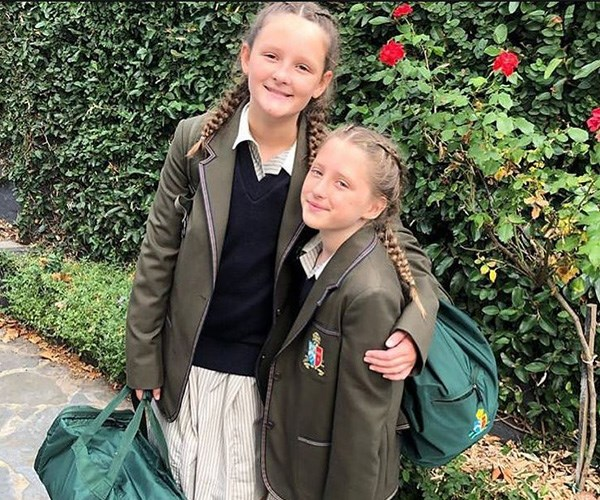 The proud parents both shared this snap of Leni on her first day of high school and Lulu's first day of grade four. *(Image: Instagram @brendanfevola25)*