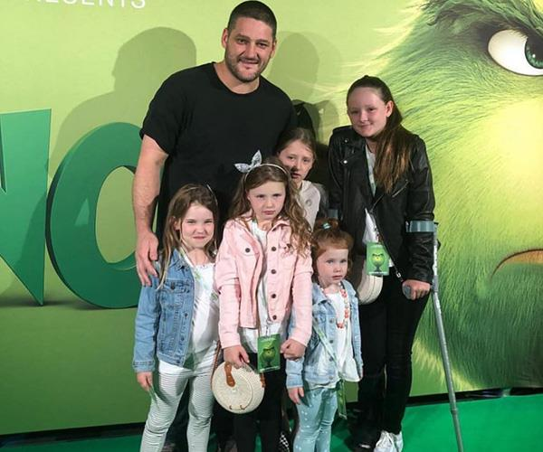 Fev loves spoiling his girls by the look of things, here they are at the *Grinch* movie premiere. *(Image: Instagram @lenifevola)*
