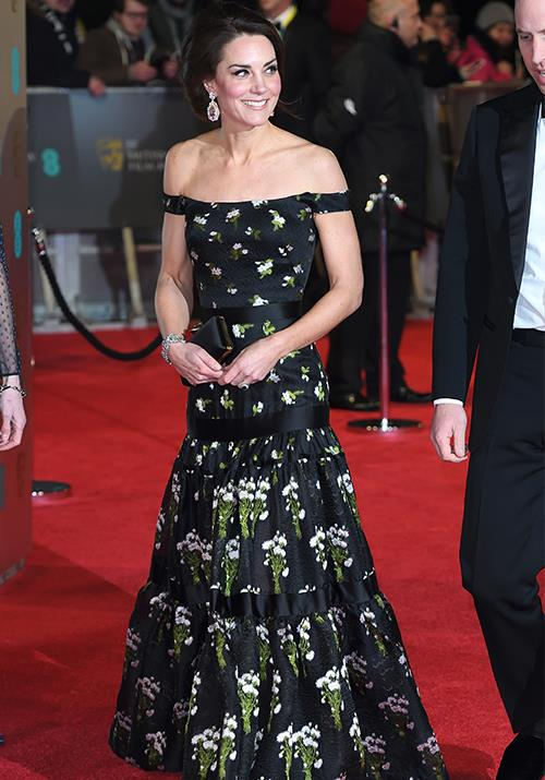 With her husband being named president of the British Academy of Film and Television Arts (BAFTA), it's no wonder Kate glammed things up a notch for the BAFTA Awards themselves in 2017. Her off-shoulder Alexander McQueen gown was a standout on Britain's night of nights. *(Image: Getty)*