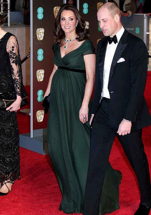 And she did it again! The very next year, to be exact. Duchess Catherine, who was six months pregnant with Prince Louis at the time, stunned at the 2018 BAFTA Awards in a moss green Jenny Packham gown. *(Image: Getty)*