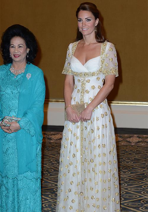 Her first year as a royal was off to a roaring start, and in 2012, Duchess Catherine kept the goods coming. She wore this gorgeous custom Alexander McQueen gown in white with gold detailing while visiting Malaysia - what a vision! *(Image: Getty)*