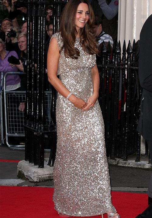 What's a princess without a little sparkle? Kate the Great shone once again as she attended the Tusk Conservation Awards in 2013 in a sequined Jenny Packham dress shortly after giving birth to Prince George. *(Image: Getty)*