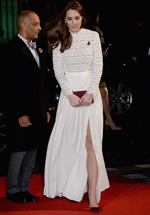 A vision in white! Duchess Catherine's light Self Portrait ensemble worn to the *A Street Cat Named Bob* film premiere in 2016 was a red carpet standout. *(Image: Getty)*