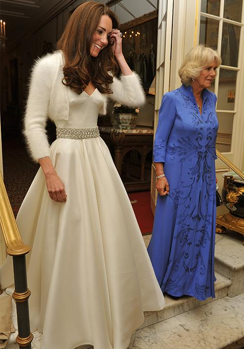 "Let's go back to where it all began - Duchess Catherine began her life as a picture perfect royal from the get go when she wore this [stunning satin gown](https://www.nowtolove.com.au/royals/british-royal-family/pippa-middleton-wears-second-wedding-dress-at-reception-37648|target=""_blank"") and angora bolero cardigan to her second wedding reception. Her dress was designed by Sarah Burton, the creator behind her stunning wedding dress. *(Image: Getty)*"