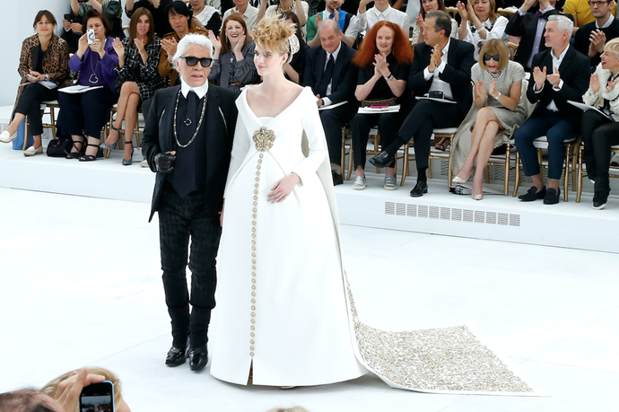 Always one to take risks, Karl's signature couture bride at his Haute Couture Fall/Winter 2014-2015 collection was a pregnant model. *(Image: Getty)*