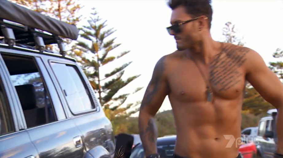 Sam as a shirtless river boy in *Home and Away*.