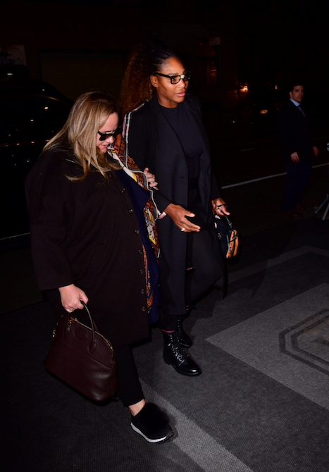 Serena opted for a chic all-black ensemble complete with dark-framed glasses. *(Image: Getty)*