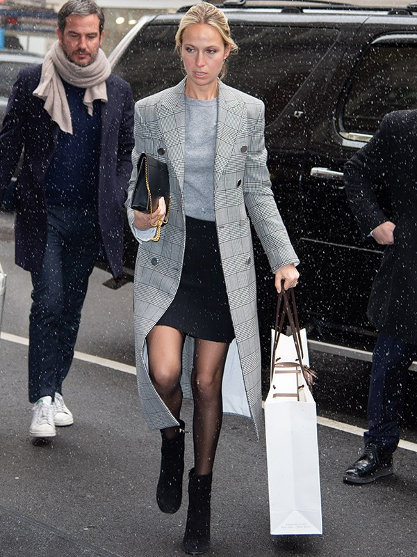 Fashion designer Misha Nonoo looked ultra chic in her grey plaid coat. *(Image: Getty Images)*