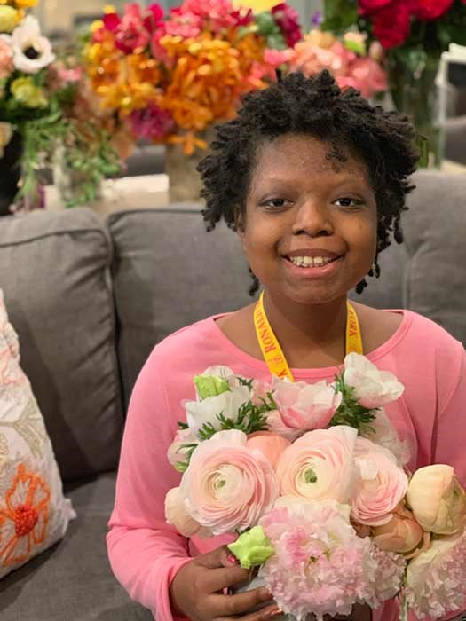 A cancer patient at Ronald McDonald house with a bouquet of Meghan's flowers. *(Image: Repeat Roses)*