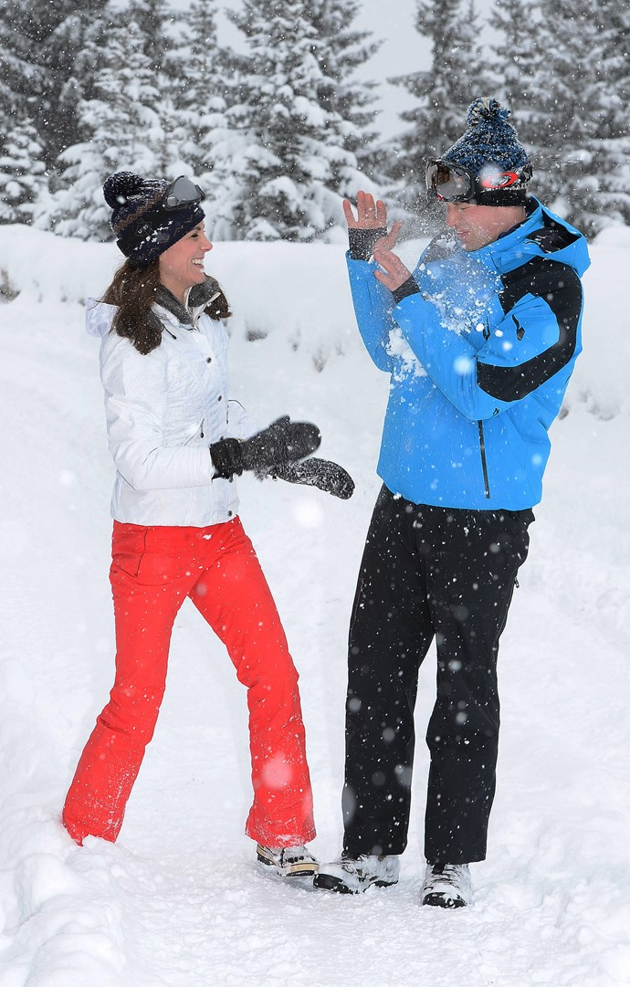 Kate and Wills frolicking in the snow. *(Image: Getty)*