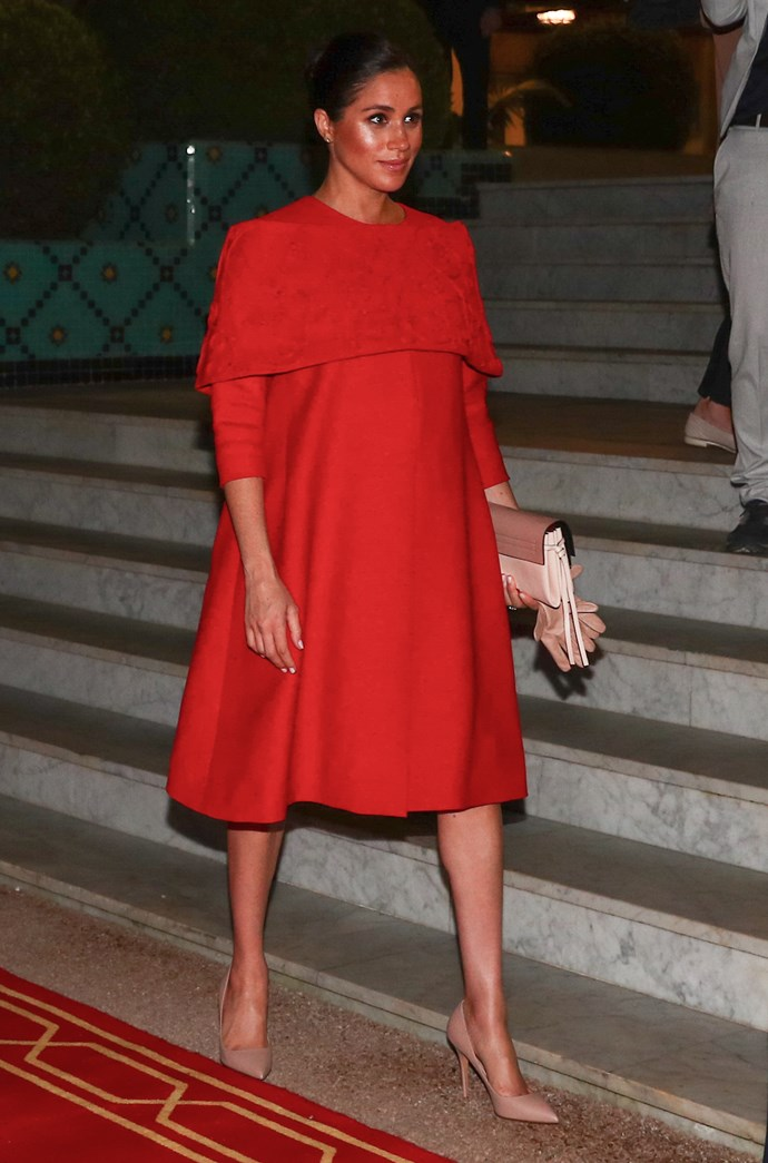 The Duchess looked stunning in a red Valentino gown. *(Image: Getty)*