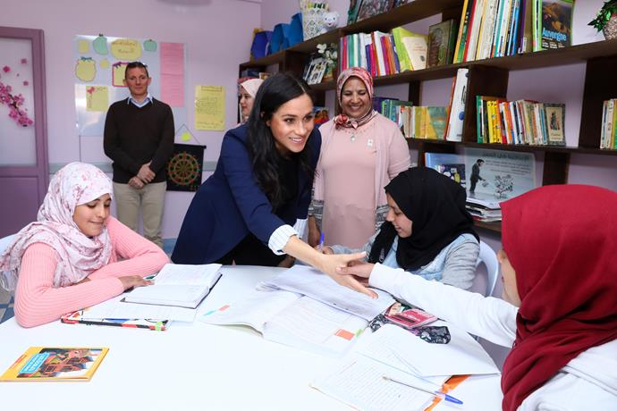 Meghan impressed guests when she spoke fluent French to the students! *(Image: Getty)*