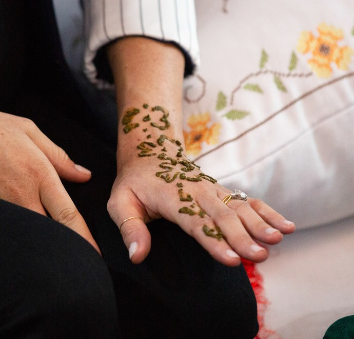 The Duchess was given a Henna design on her hand and wrist. *(Image: Getty)*