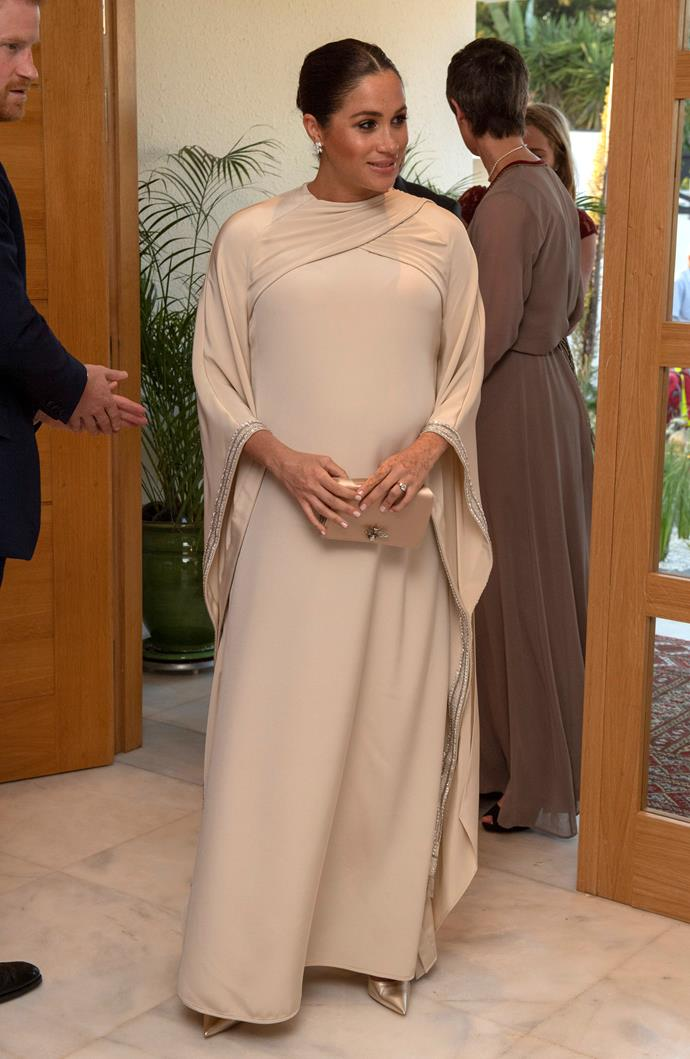Meghan looked divine in a white custom Dior creation. *(Image: Getty)*