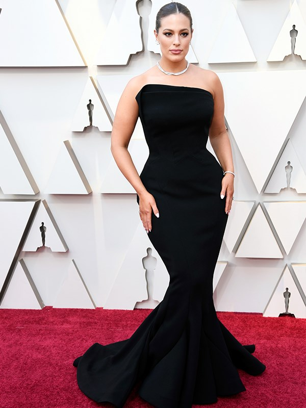 Va va voom! Ashley Graham manages to pull off classic and sexy in this perfect black Zac Posen number.