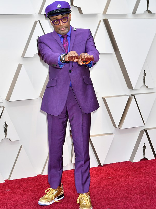 Best director nominee Spike Lee clashes spectacularly with the red carpet in a purple suit.