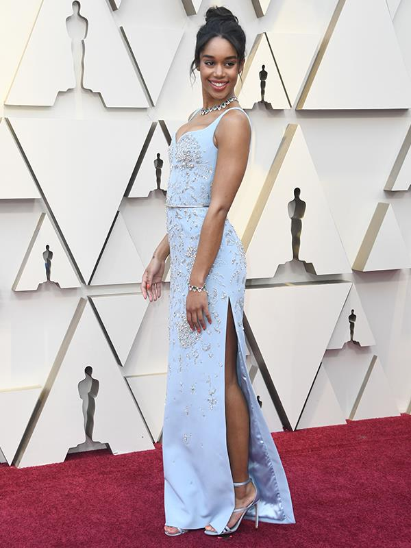Star of best picture nominee *BlacKkKlansman*, 28-year-old Laura Harrier looks picture perfect in this embellished blue gown by Louis Vuitton.
