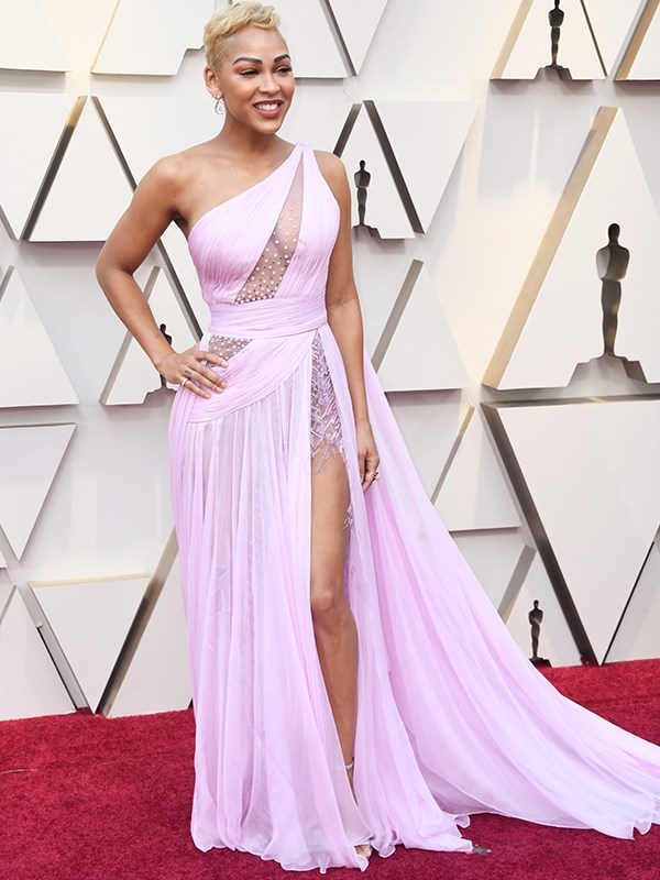 American actress Meagan Good flaunts her assets in this pink gown with sheer detailing - and another thigh high split.