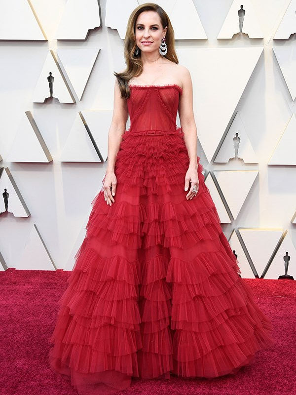 Mexican actress Marina de Tavira channels the red carpet quite literally in this rouge J. Mendel gown, and we're here for it.