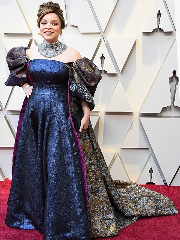 Costume designer Ruth E. Carter is no stranger to a flamboyant ensemble, and she hasn't disappointed tonight.