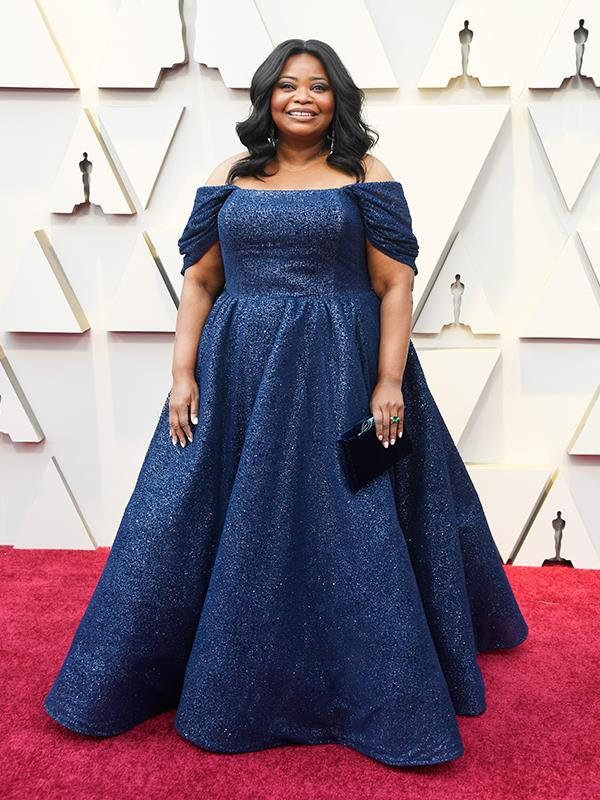 The beautiful Octavia Spencer looks elegant and sophisticated in a midnight blue Christian Siriano gown.