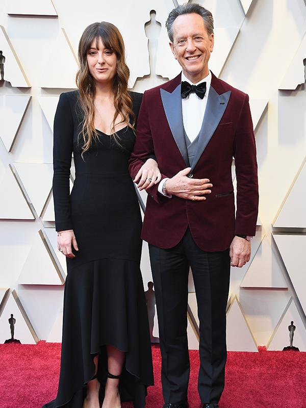 Swazi-English actor Richard E. Grant looks dapper in a maroon blazer - and partner Olivia is clearly proud as punch.