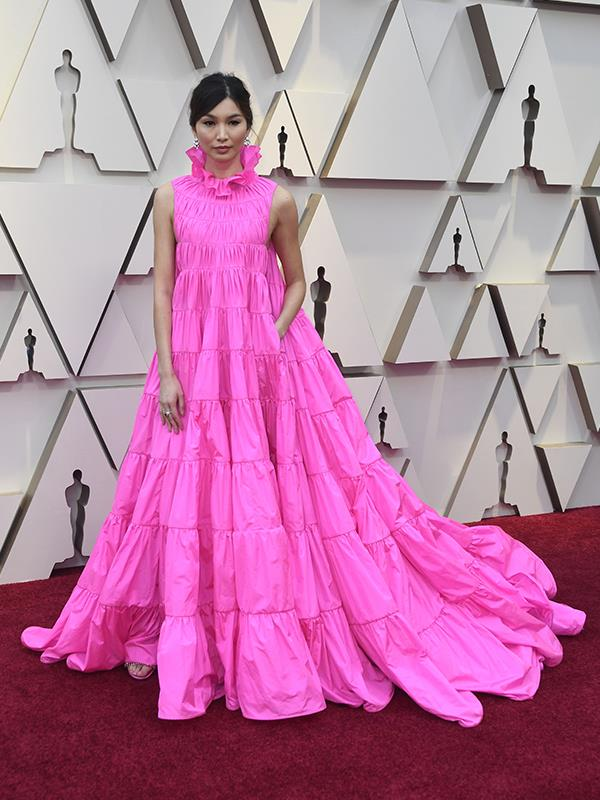 The stars of *Crazy Rich Asians* have well and truly stolen the show tonight - actress Gemma Chan commands our full attention in this gloriously bright pink Valentino gown.