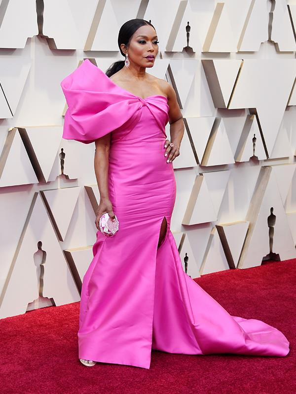 Pink is officially the new black! Actress Angela Bassett's Reem Acra dress gives new meaning to the power-shoulder.
