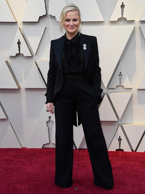 She means business! Comedic actress and presenter Amy Poehler opts for an all-black pant suit.